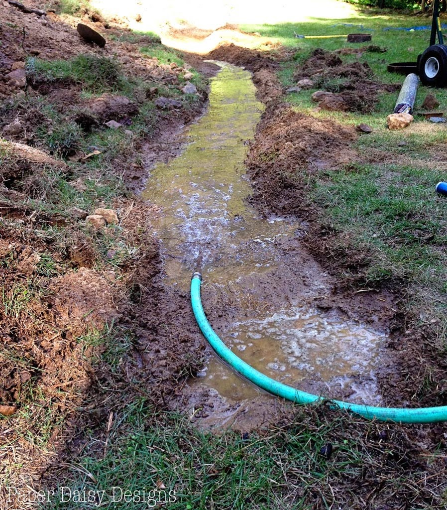 a dry creek bed for beauty and drainage