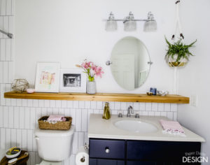 Vertical subway tile behind bathroom vanity