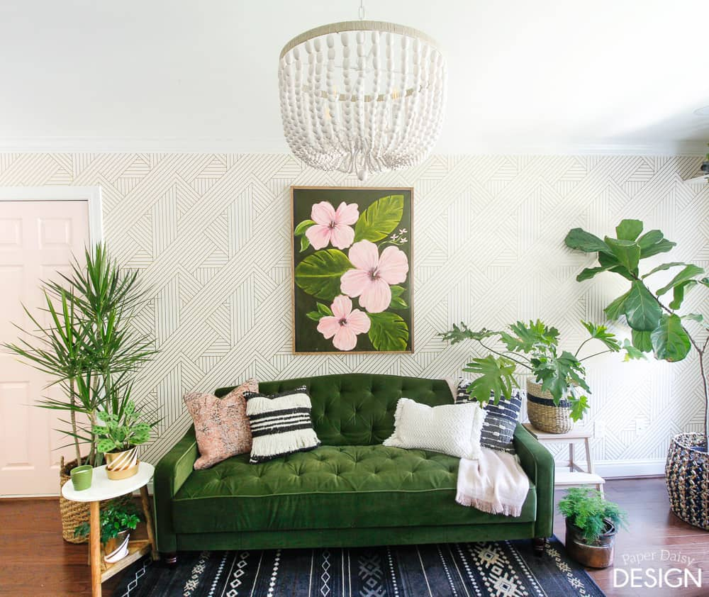 Green velvet sofa with pink door