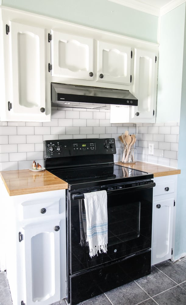 white glass tile backsplash with grey grout