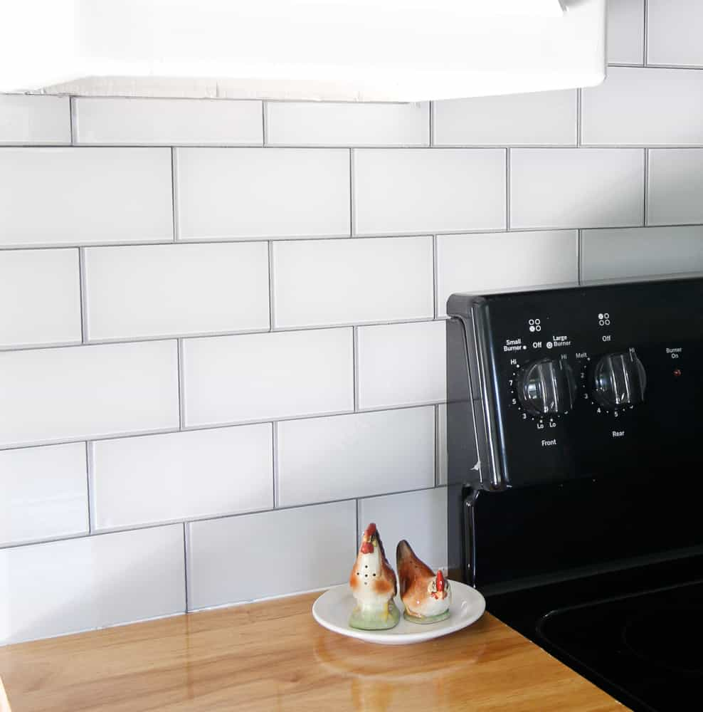 Installed glass tile backsplash