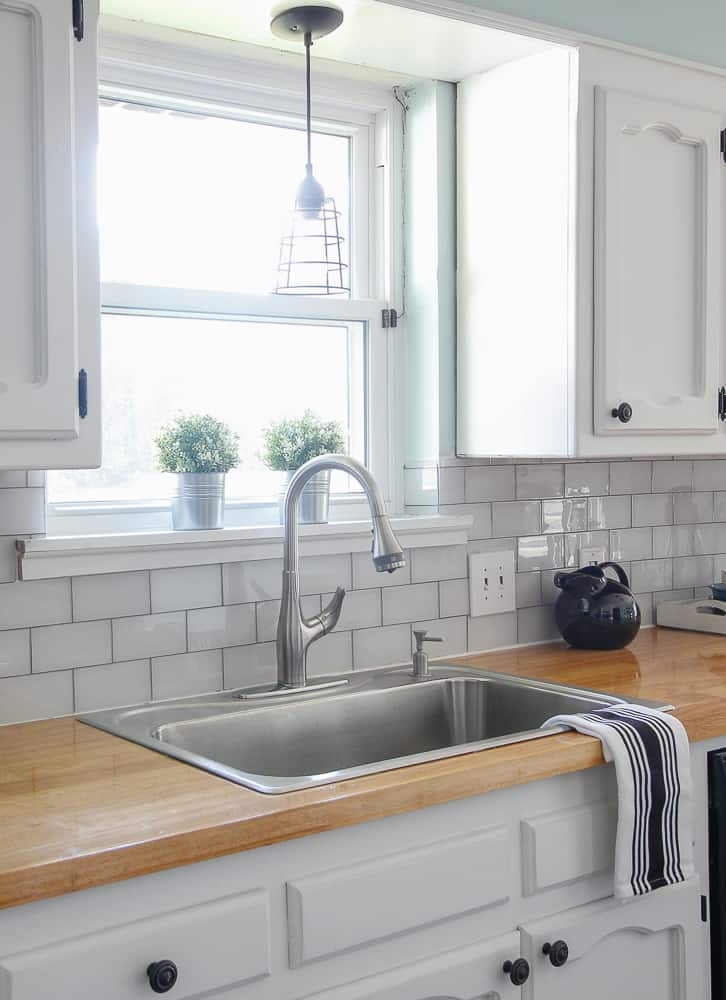 glass tile in white with grey grout kitchen backsplash