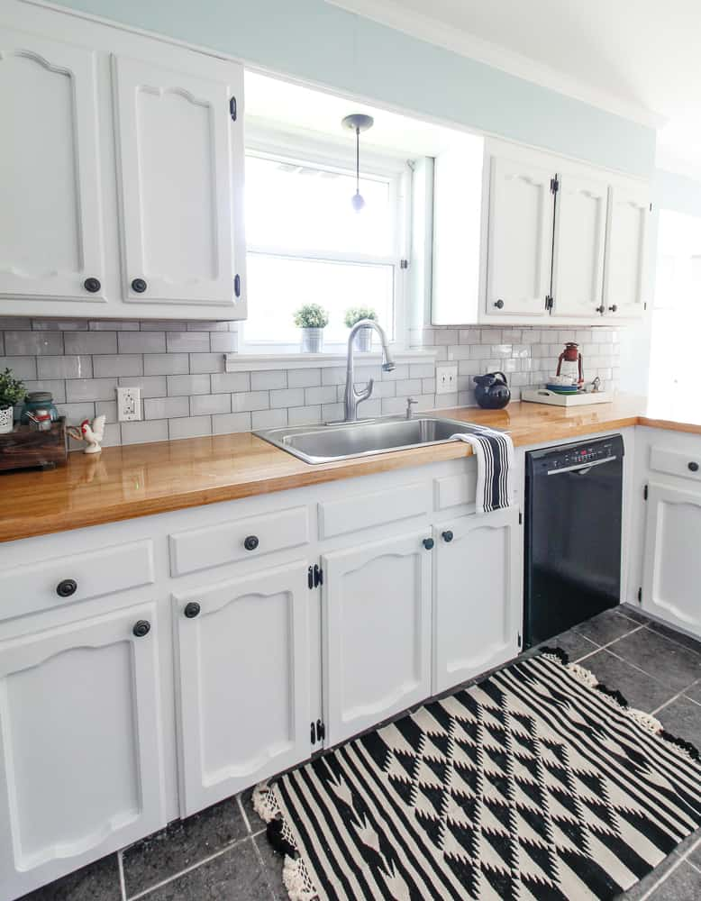 kitchen with white glass tile backsplash and grey grout