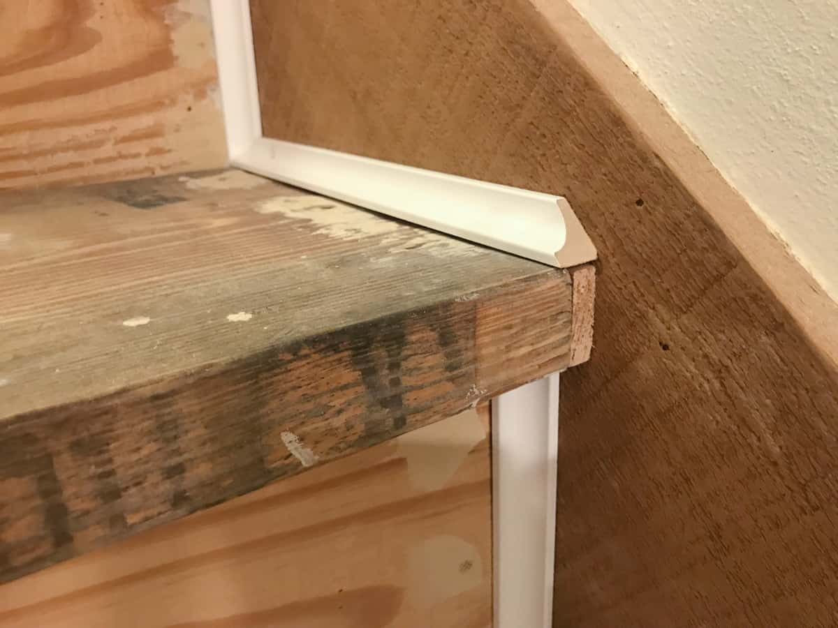 Add trim to cover gaps in stairs