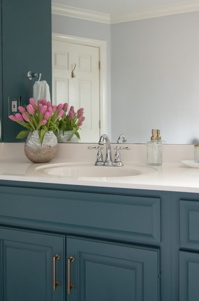 Teal painted cabinets in bathroom