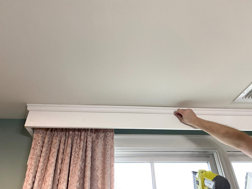 add trim to the cornice to cover the curtain rod