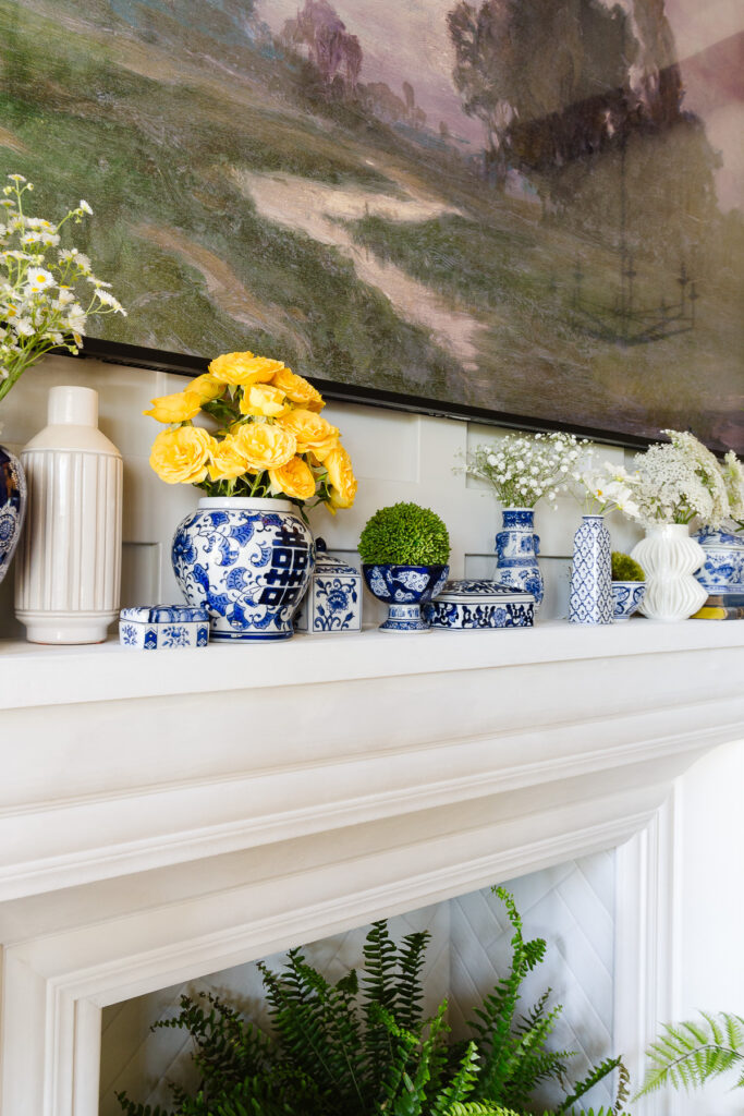 blue and white porcelain on mantel styled for summer